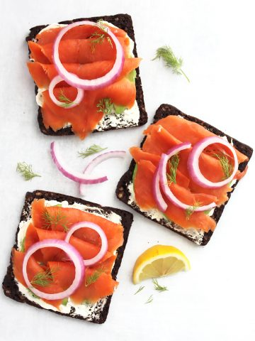 Overhead shot of there open faced smoked salmon sandwiches.