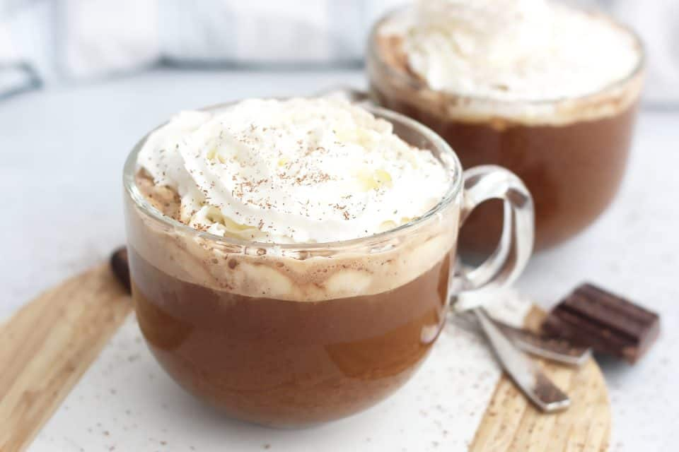 Two coconut mochas served in glass cups.