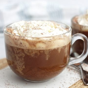A coconut mocha with whipped cream in a glass cup.