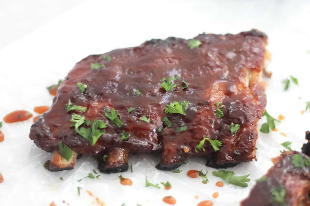 Maple bbq ribs garnished with fresh parsley.