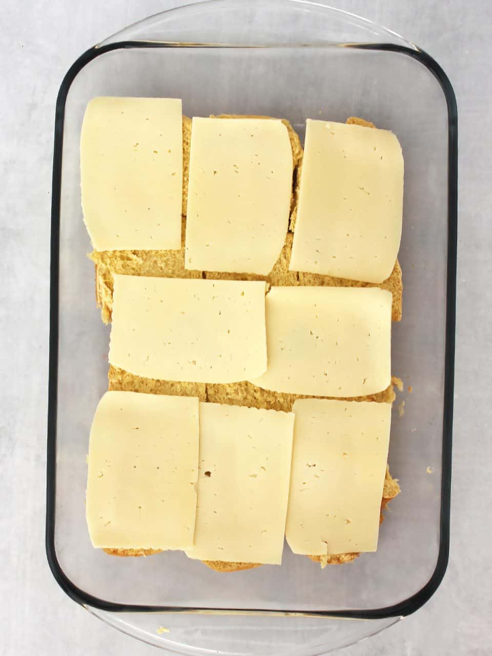 Cheese slices placed on top of the buns.